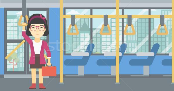Vrouw openbaar vervoer asian jonge vrouw permanente Stockfoto © RAStudio