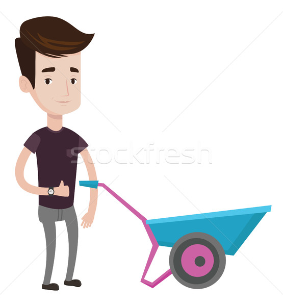 Man with wheelbarrow vector illustration. Stock photo © RAStudio