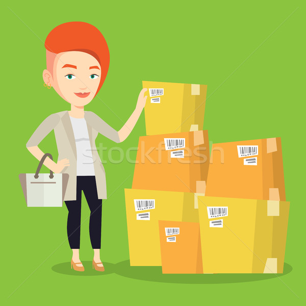 Business woman checking boxes in warehouse. Stock photo © RAStudio