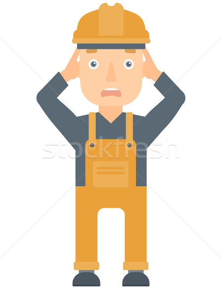 Stressful engineer clutching his head. Stock photo © RAStudio