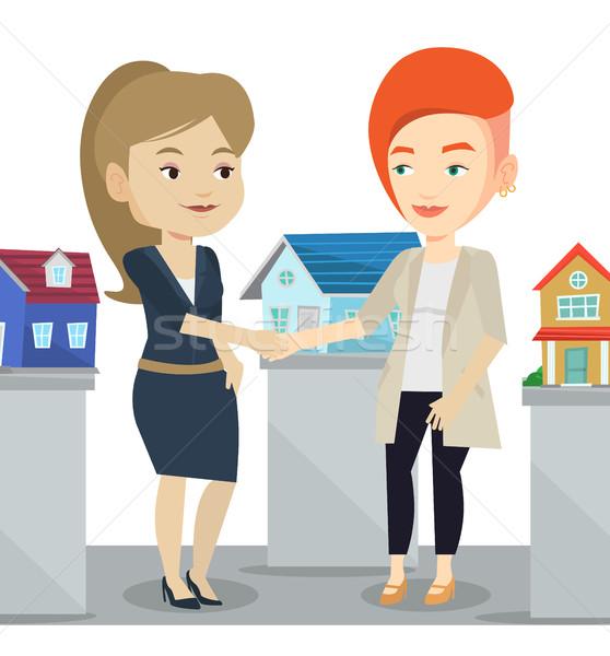 соглашение покупатель кавказский агент по продаже недвижимости рукопожатие Сток-фото © RAStudio
