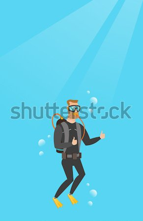 Man diving with scuba and showing thumb up. Stock photo © RAStudio