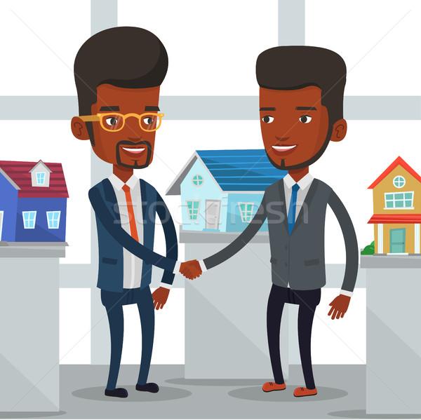 Accordo agente immobiliare acquirente giovani african agente immobiliare Foto d'archivio © RAStudio