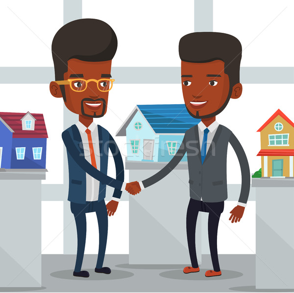 Accord agent immobilier acheteur jeunes africaine agent immobilier Photo stock © RAStudio
