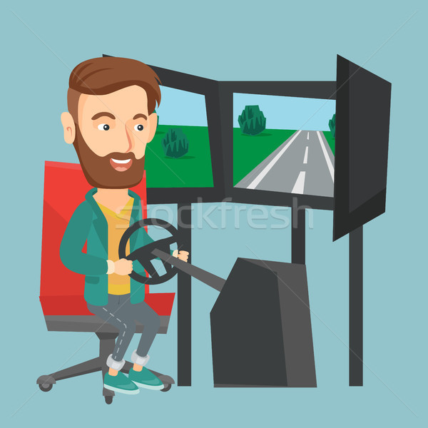 Man playing video game with gaming wheel. Stock photo © RAStudio