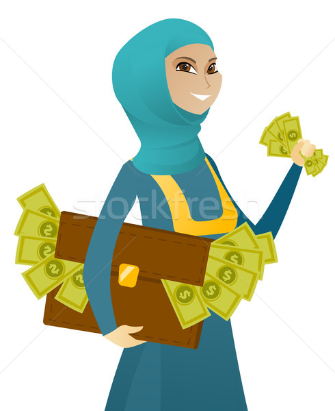 Muslim business woman with briefcase full of money Stock photo © RAStudio