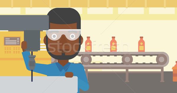 Man working on milling machine. Stock photo © RAStudio