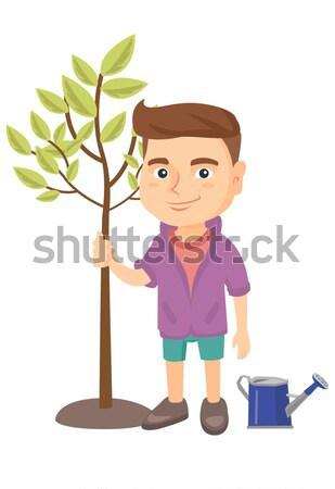 Asian smiling boy  planting a tree. Stock photo © RAStudio