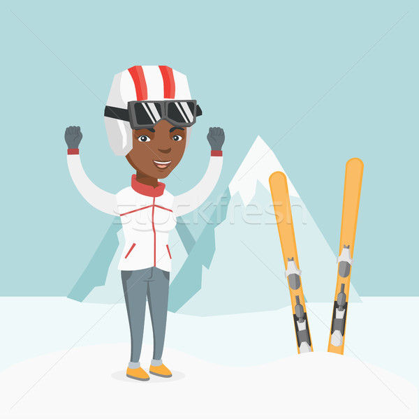 Jonge afrikaanse skiër permanente opgeheven handen bergen Stockfoto © RAStudio