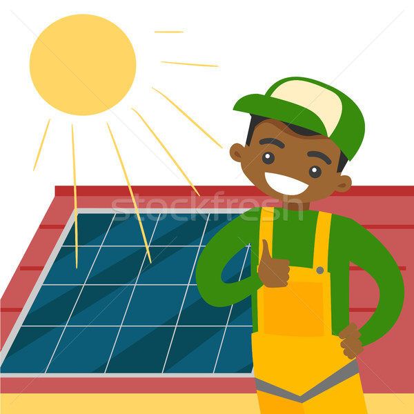 Stock photo: Young african constructor installing solar panel