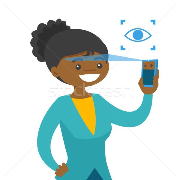 Afroamerikai nő szemek okostelefon szem arculat technológia Stock fotó © RAStudio