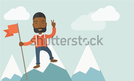 Happy caucasian standing on top of the mountain. Stock photo © RAStudio