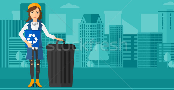 Woman with recycle bins. Stock photo © RAStudio
