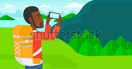 Hátizsákos turista elvesz fotó ázsiai férfi tájkép Stock fotó © RAStudio