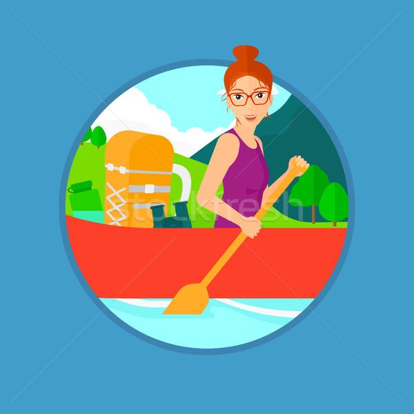 Woman riding in kayak. Stock photo © RAStudio