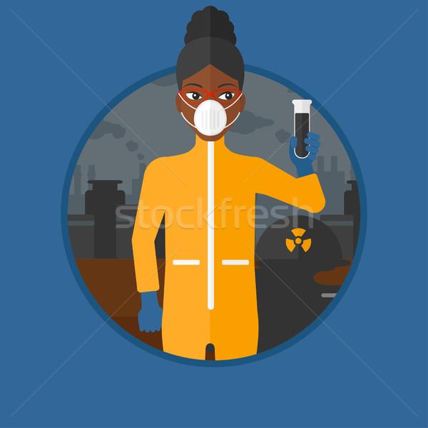 Kadın radyasyon takım elbise deney tüpü siyah Stok fotoğraf © RAStudio