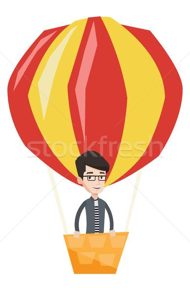 человека Flying воздушном шаре счастливым кавказский Постоянный Сток-фото © RAStudio