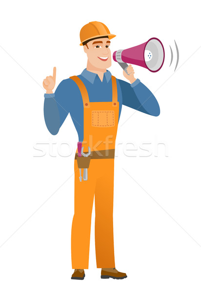 Young caucasian builder making announcement . Stock photo © RAStudio