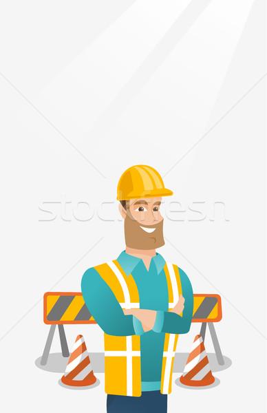 Confident builder with arms crossed. Stock photo © RAStudio