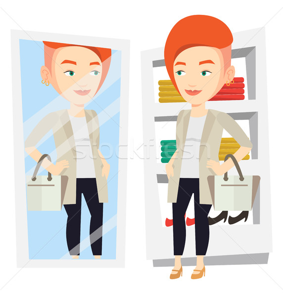 Donna vestiti spogliatoio guardando specchio ragazza Foto d'archivio © RAStudio