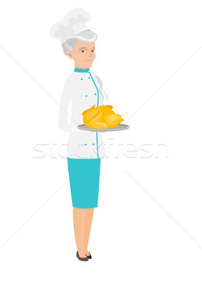 Senior chef pollo Foto d'archivio © RAStudio
