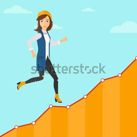 Zakenvrouw lopen naar boven jonge zakenvrouw omhoog Stockfoto © RAStudio