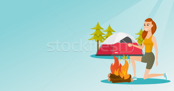 Young caucasian white woman making the campfire. Stock photo © RAStudio
