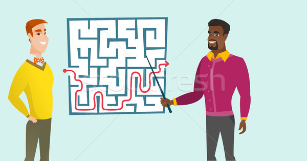 Business men looking at labyrinth with solution. Stock photo © RAStudio