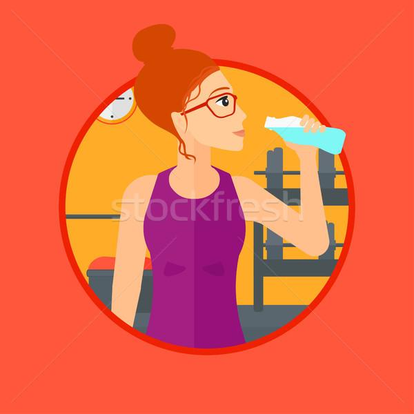 Sportive woman drinking water. Stock photo © RAStudio
