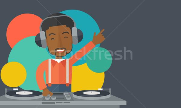 DJ with console. Stock photo © RAStudio