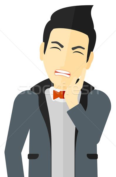 Man suffering from tooth pain. Stock photo © RAStudio