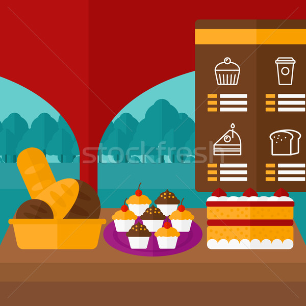 Background of bakery with table full of bread and pastries. Stock photo © RAStudio