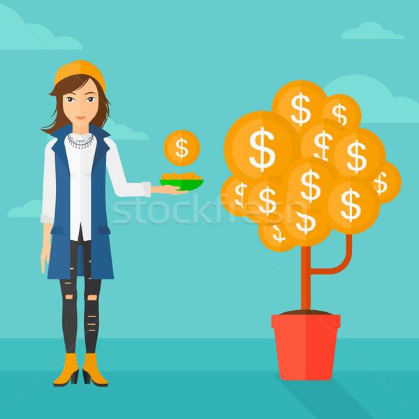 Woman catching dollar coins. Stock photo © RAStudio