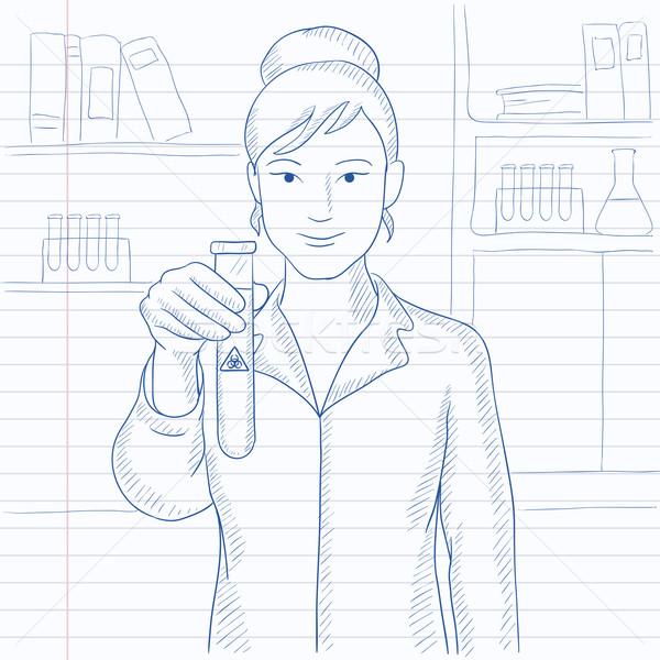 Laboratory assistant with test tube. Stock photo © RAStudio
