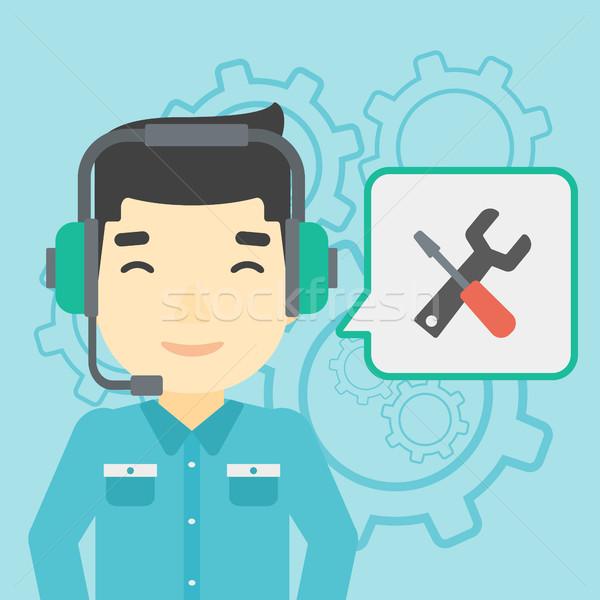 Technische ondersteuning exploitant asian hoofdtelefoon ingesteld Stockfoto © RAStudio