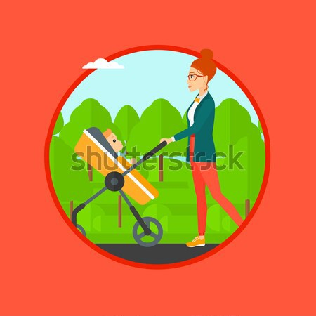 Mother walking with her baby in stroller. Stock photo © RAStudio
