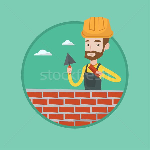 каменщик рабочих кирпичных молодые равномерный Сток-фото © RAStudio