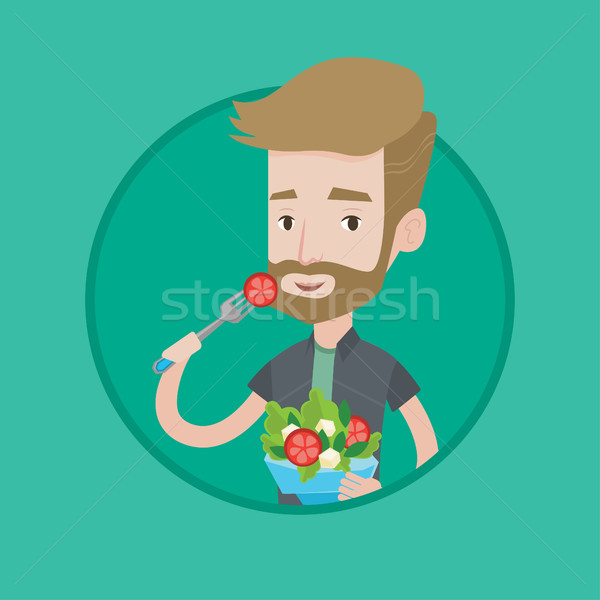 Uomo mangiare sano vegetali insalata giovane Foto d'archivio © RAStudio