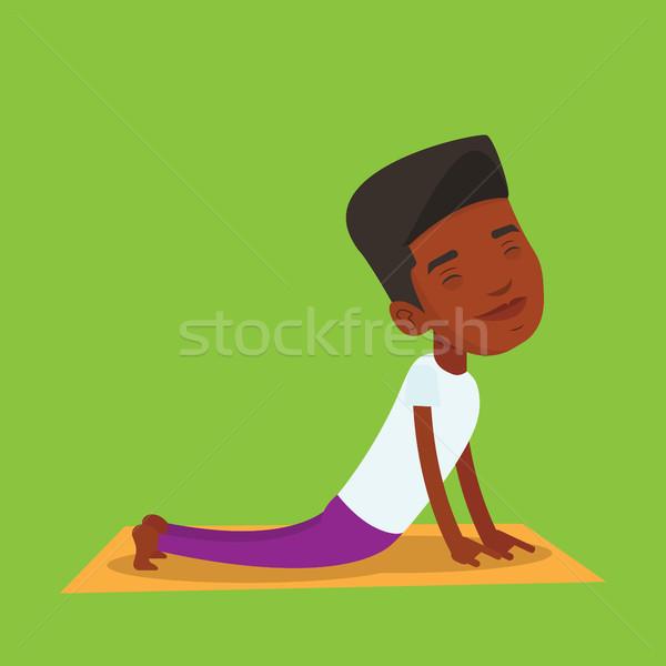 Man practicing yoga upward dog pose. Stock photo © RAStudio