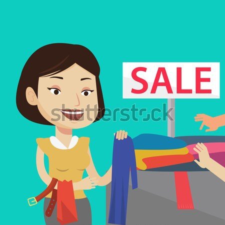 Jonge vrouw kiezen kleding winkel verkoop kaukasisch Stockfoto © RAStudio
