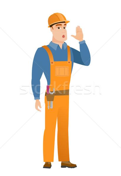 Caucasian builder calling for help. Stock photo © RAStudio
