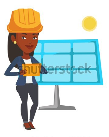 Asian worker of solar power plant. Stock photo © RAStudio