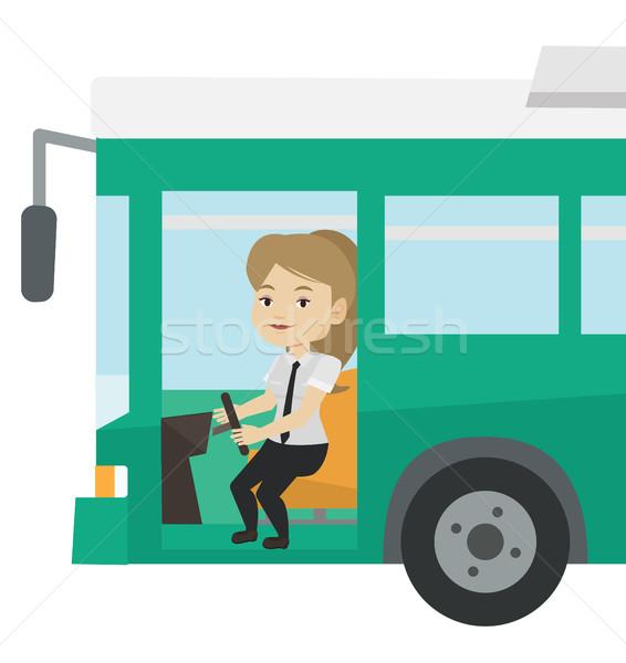Caucasian bus driver sitting at steering wheel. Stock photo © RAStudio