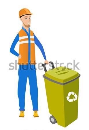 Caucasian builder pushing recycle bin. Stock photo © RAStudio