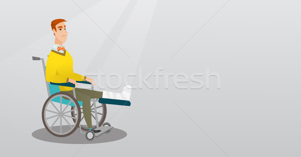Stock photo: Man with broken leg sitting in a wheelchair.