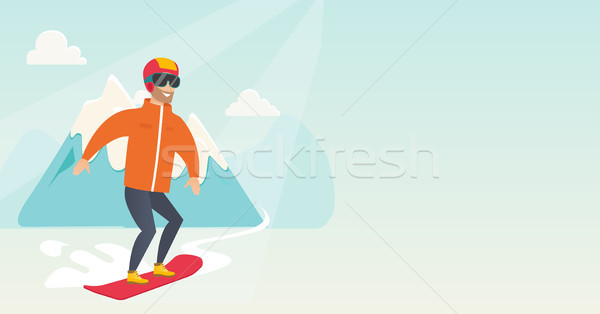 Young caucasian man snowboarding. Stock photo © RAStudio