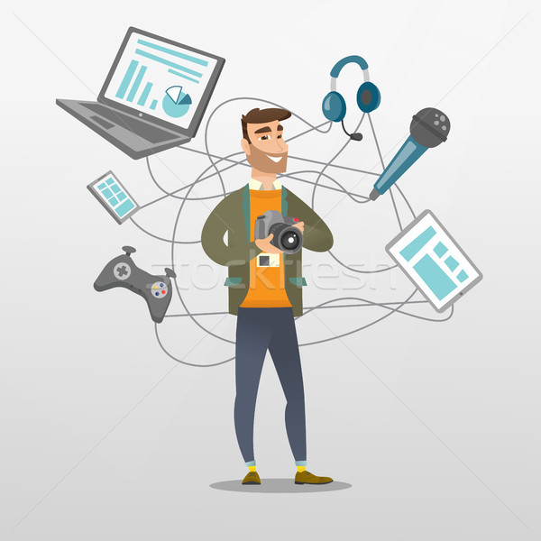 Young caucasian man surrounded by her gadgets. Stock photo © RAStudio