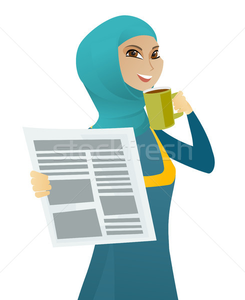 Stock photo: Muslim woman drinking coffee and reading newspaper