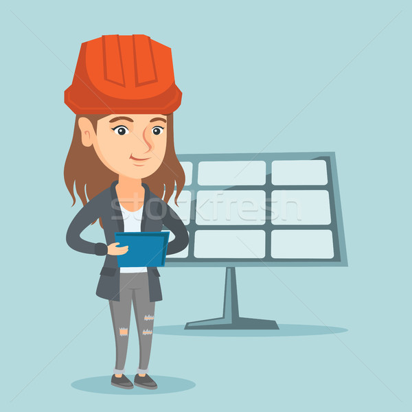 Worker of solar power plant using a digital tablet Stock photo © RAStudio
