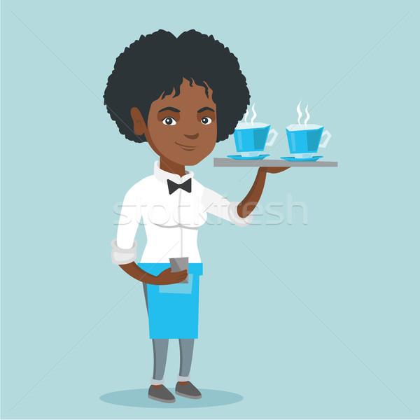 Waitress holding tray with cups of coffeee or tea. Stock photo © RAStudio